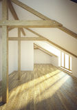 Empty mansard room with windows Royalty Free Stock Photography