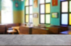 Empty marble stone table in front of abstract blurred background of restaurant, cafe and coffee shop interior. royalty free stock photography