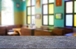 Empty marble stone table in front of abstract blurred background of restaurant, cafe and coffee shop interior. royalty free stock images