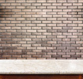 Empty marble table and brick wall in background. product display Royalty Free Stock Photos