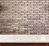 Empty marble table and brick wall in background. product display Stock Photo