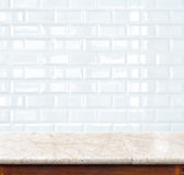 Empty marble table and ceramic tile brick wall in background. pr Stock Photo