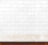 Empty marble table and ceramic tile brick wall in background. pr Royalty Free Stock Images
