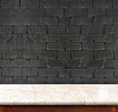 Empty marble table and white black brick wall in background. pro Royalty Free Stock Images