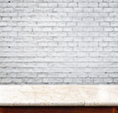 Empty marble table and white brick wall in background. product d. Isplay template stock photos