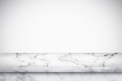 Empty marble table with white gray gradient wall background. Stock Images
