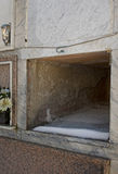 Empty marble tomb - death, mortality. Cemetery detail - space for one. Cold, with snow royalty free stock photo