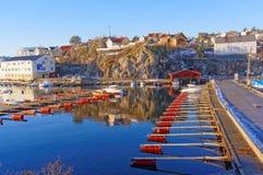 Empty marina docks with red Royalty Free Stock Photo