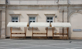 Empty Market Stalls. A row of empty market stalls in the historic Slovenian coastal town of Piran, waiting for market day Stock Image