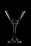 Empty  martini  glass on black background studio shot Royalty Free Stock Photo