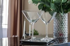 Empty martini glasses on kitchen counter Royalty Free Stock Photography