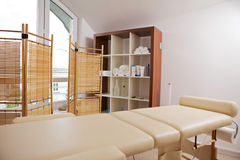 Empty massage table in room Stock Images