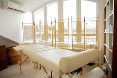 Empty massage table in room Royalty Free Stock Image