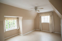 Empty master bedroom in cream and beige Royalty Free Stock Images