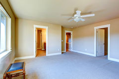 Empty master bedroom with walk-in closet and bathroom Stock Photography
