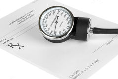 Empty medical prescription with sphygmomanometer Stock Photo