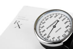 Empty medical prescription with a sphygmomanometer Stock Photography