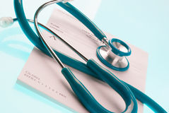 Empty medical prescription with a stethoscope Royalty Free Stock Photography