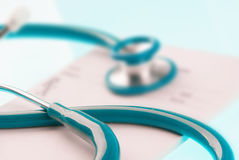 Empty medical prescription with a stethoscope Stock Photos
