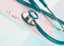 Empty medical prescription with a stethoscope. On blue reflective background Stock Photo