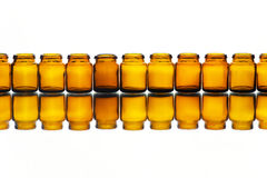 Empty medicine or cosmetic bottles. On the white background with reflection Stock Images