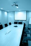 Empty meeting room. With long rectangle table and many chairs,telephone, internet access,projector above,presentation screen Royalty Free Stock Photos