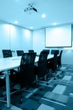 Empty meeting room. With long rectangle table and many chairs,telephone, internet access,projector above,presentation screen Stock Photos