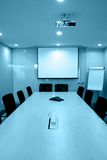 Empty meeting room. With long rectangle table and many chairs,telephone, internet access,projector above,presentation screen Stock Photo