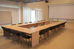 An empty meeting room. An empty meeting room with a flip chart, an overhead projector and small oratorical tribune Stock Images