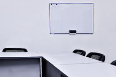 Empty meeting room in the office with tables and chairs Royalty Free Stock Images