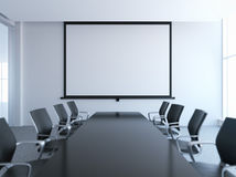 Empty meeting room with white screen Stock Photo