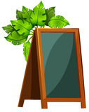 An empty menu board with plants Royalty Free Stock Photos