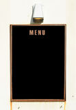 Empty menu board on wall Stock Photo