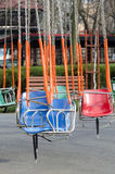 Empty merry-go-round seats Stock Image