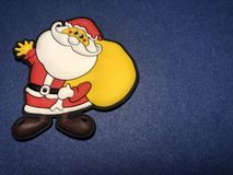 Empty message area with father christmas figure as note paper or message board on navy blue background. Empty message area with father christmas, saint nicholas Stock Photography