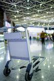 Empty metal cart for luggage standing at airport Royalty Free Stock Image
