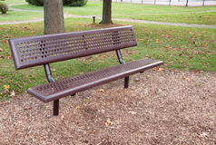 Empty metal park bench Royalty Free Stock Photo