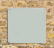 Empty metal plate on brick wall Stock Photos