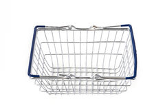 Empty metal shopping basket with blue handles Royalty Free Stock Photos