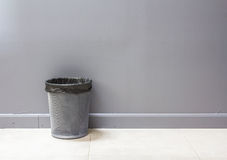 An empty metal trashcan (bin) isolated on gray Stock Images