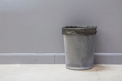 An empty metal trashcan (bin) isolated Royalty Free Stock Images