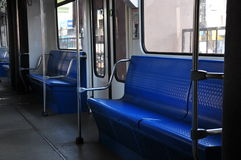 Empty Metro Train. An empty metro train passenger carriage. Seats readily available to early commuters Royalty Free Stock Image