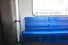 Empty Metro Train Seat. An empty metro train passenger carriage. Seats readily available to early commuters Royalty Free Stock Photography