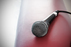 Empty mic. Microphone waiting to be used with cord attached Royalty Free Stock Image