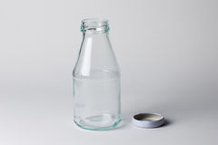 Empty milk glass bottle Stock Photo