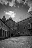 Empty misterious courtyard of an old stone castle Royalty Free Stock Images