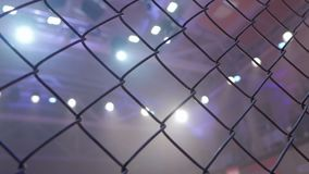 Empty mma cage arena octagon ring for fights. Mixed Martial arts fight. Light beams flashing spotlights stock video