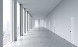 Empty modern bright clean interior of an open space office. Huge panoramic windows  Royalty Free Stock Photography
