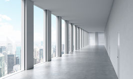 Empty modern bright clean interior of an open space office. Huge panoramic windows with New York view. A concept of luxury space f Royalty Free Stock Images