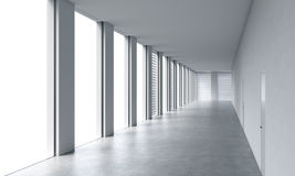 Empty modern bright clean interior of an open space office. Huge panoramic windows with white copy space and white walls. A concep Royalty Free Stock Images
